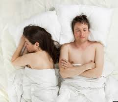 disconnected couple in bed